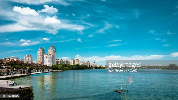 view of city at waterfront - kiev stock pictures, royalty-free photos & images