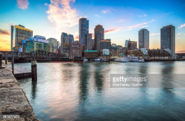 view of city at waterfront - boston skyline stock pictures, royalty-free photos & images
