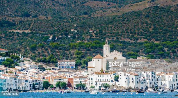 view of city at waterfront - cadaques stock pictures, royalty-free photos & images