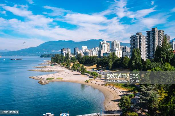view of city at waterfront - vancouver stock pictures, royalty-free photos & images