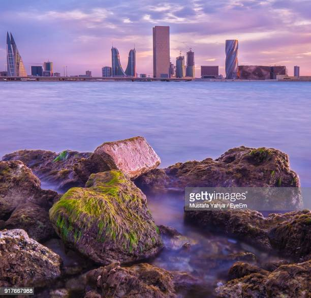 view of city at waterfront - bahrain stock pictures, royalty-free photos & images