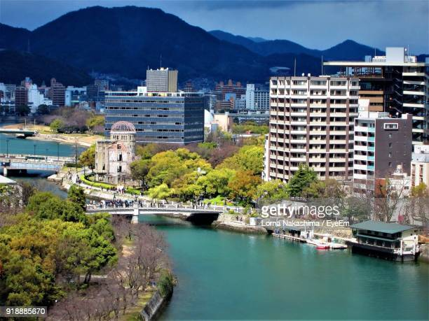 view of city at waterfront - hiroshima city stock photos and pictures