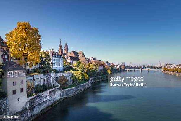 view of city at waterfront - basel switzerland stock pictures, royalty-free photos & images