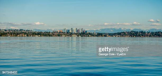 view of city at waterfront - bellevue skyline stock pictures, royalty-free photos & images
