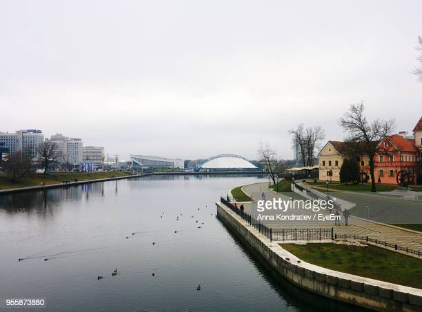 view of city at waterfront - minsk stock pictures, royalty-free photos & images