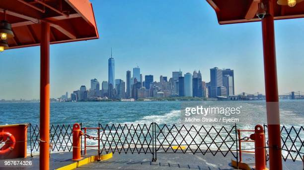 view of city at waterfront - staten island stock pictures, royalty-free photos & images
