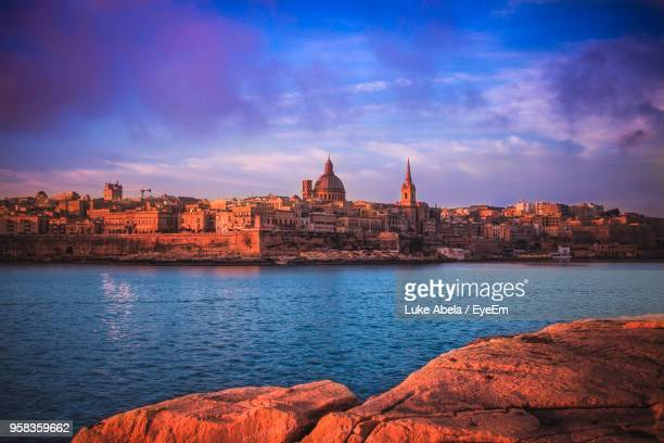 view of city at waterfront - valletta stock pictures, royalty-free photos & images