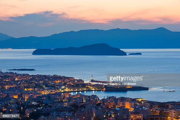 View of city from hillside at dusk, Hania, Crete