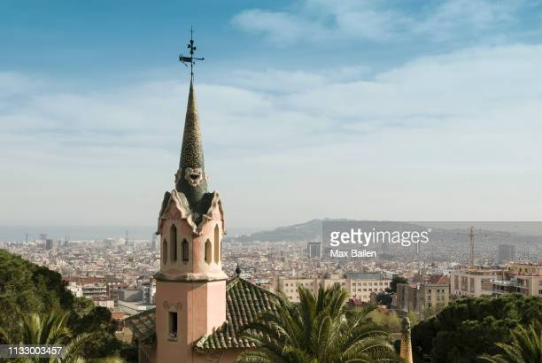 view of city from park guell, barcelona, spain - torenspits stockfoto's en -beelden