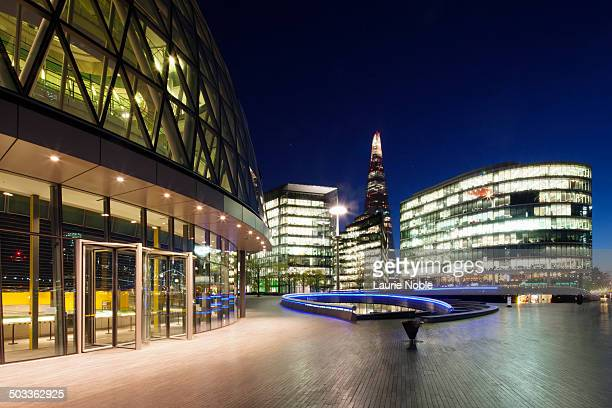 view of city hall, the scoop and offices at dusk - square stock pictures, royalty-free photos & images