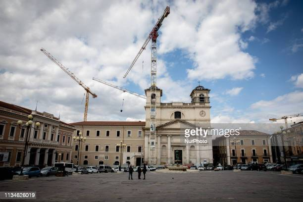 View of city square Piazza del Duomo in downtown of L'Aquila, Italy, on April 3, 2019 about ten years on from the April 6, 2009 earthquake that...