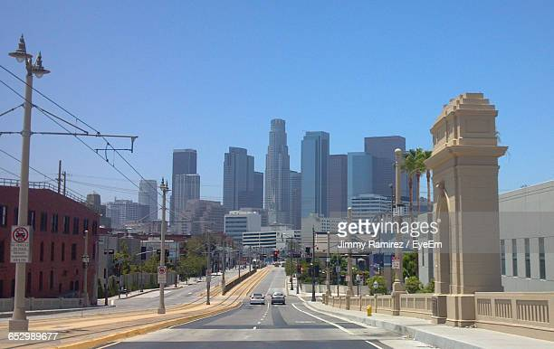 view of city street against clear sky - los angeles photos et images de collection