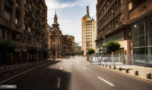 view of city street against sky - bucharest stock pictures, royalty-free photos & images
