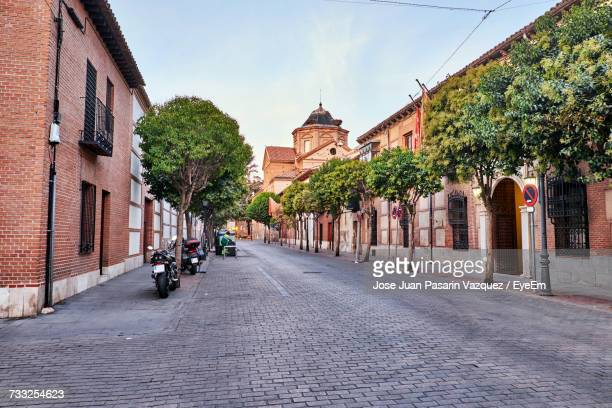 view of city street against sky - alcala de henares stock pictures, royalty-free photos & images
