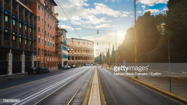 view of city street against sky - coliseum rome stock photos and pictures