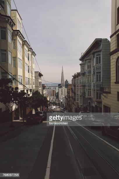 view of city street against sky - bortes stockfoto's en -beelden
