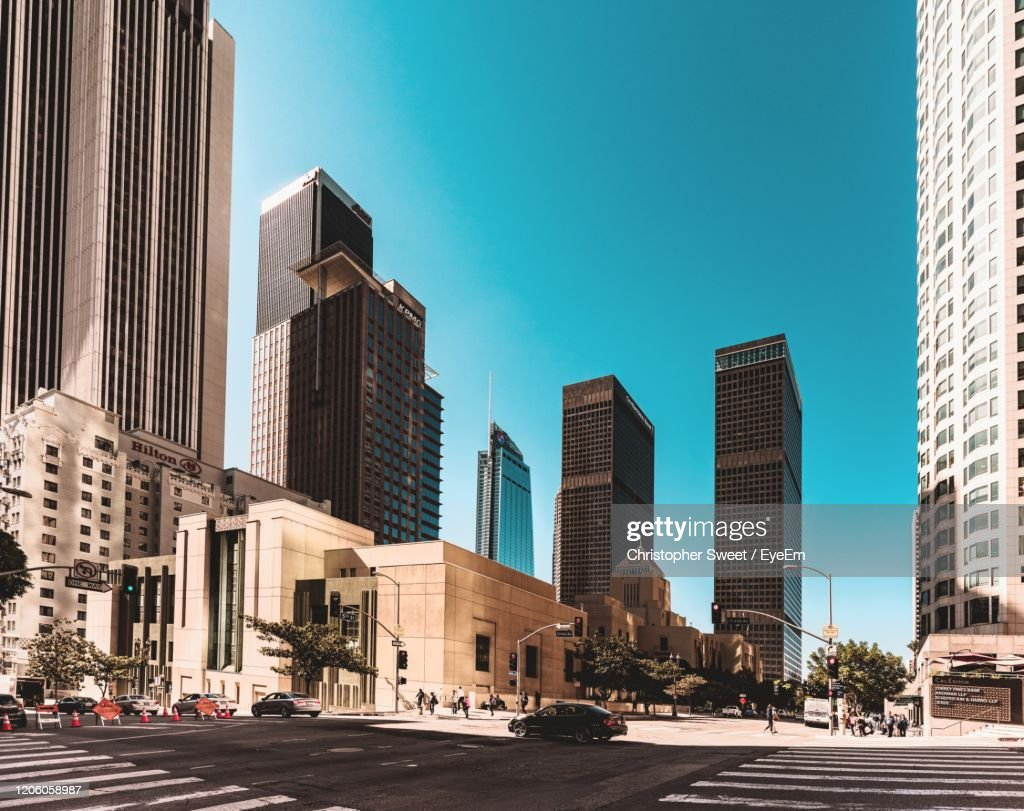 View Of City Street And Buildings Against Blue Sky : Foto de stock