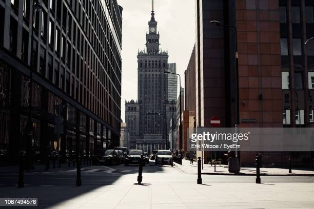 view of city street and buildings - warsaw stock pictures, royalty-free photos & images
