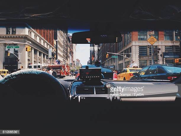 View of city through car windscreen
