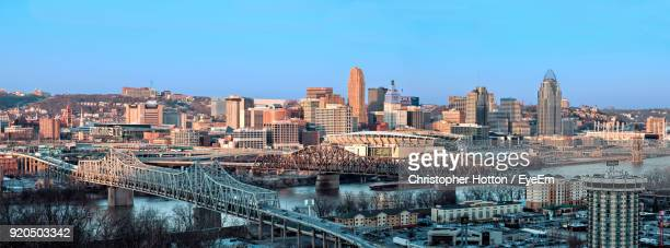 view of cityscape against blue sky - cincinnati stock pictures, royalty-free photos & images