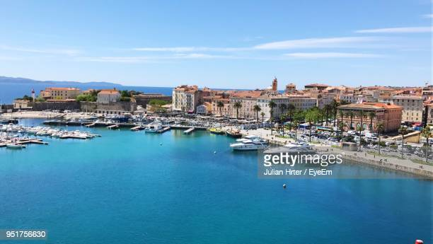 view of cityscape against blue sky - corsica photos et images de collection