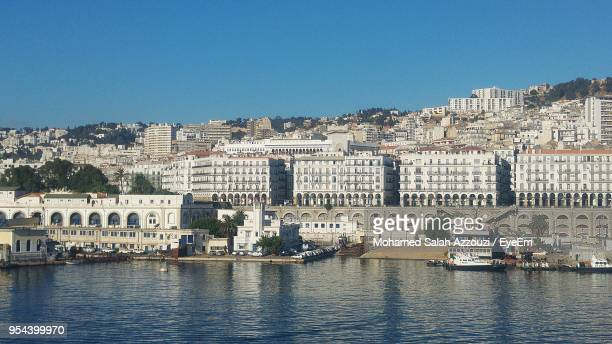view of cityscape against clear blue sky - algiers algeria stock pictures, royalty-free photos & images