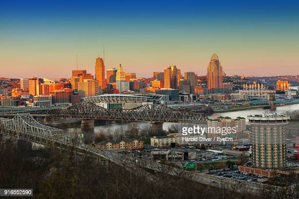 view of cityscape against clear sky during sunset - cincinnati stock pictures, royalty-free photos & images