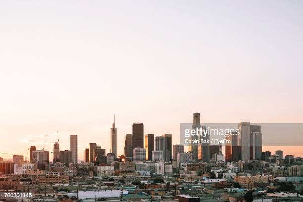 view of cityscape against clear sky - los angeles foto e immagini stock