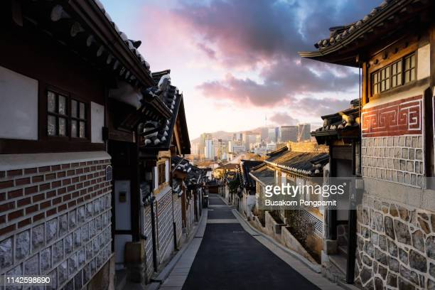 view of cityscape against cloudy sky. bukchon hanok village and n seoul tower - seoul stock pictures, royalty-free photos & images