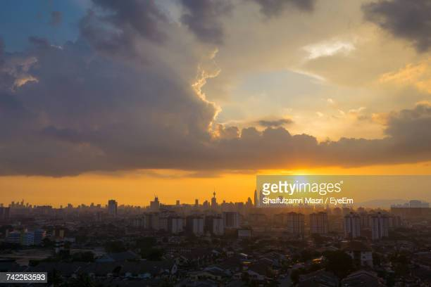 view of cityscape against cloudy sky during sunset - shaifulzamri photos et images de collection