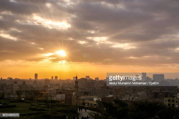 view of cityscape against cloudy sky during sunset - egyptian culture stock photos and pictures