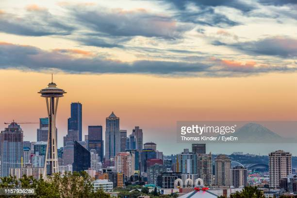 view of cityscape against cloudy sky - seattle stock pictures, royalty-free photos & images