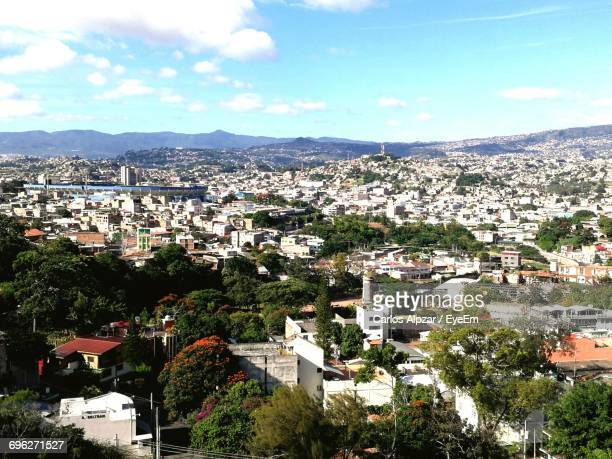 view of cityscape against cloudy sky - honduras stock pictures, royalty-free photos & images