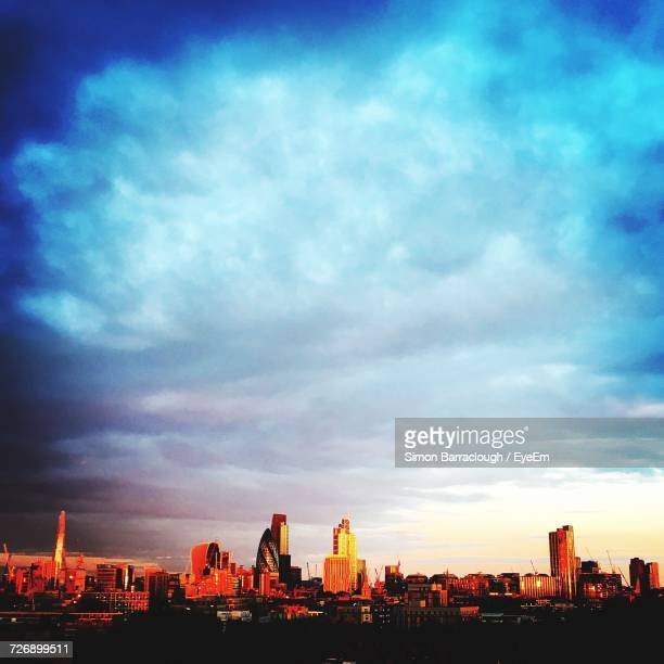 view of cityscape against cloudy sky - bethnal green stock pictures, royalty-free photos & images