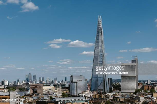 view of cityscape against cloudy sky - shard london bridge stock pictures, royalty-free photos & images