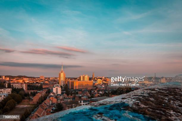 view of cityscape against cloudy sky - leuven stock pictures, royalty-free photos & images