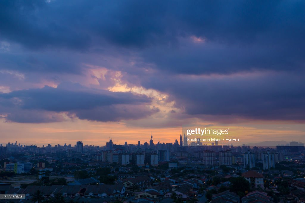 View Of Cityscape Against Cloudy Sky : Stock-Foto