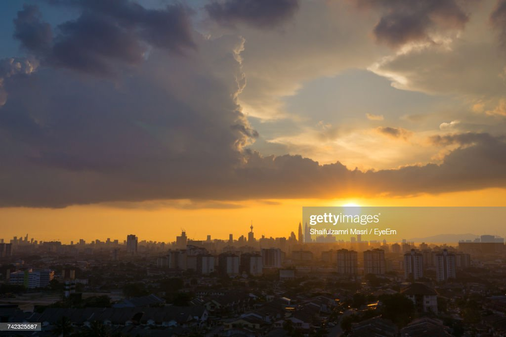 View Of Cityscape Against Cloudy Sky : Stock Photo