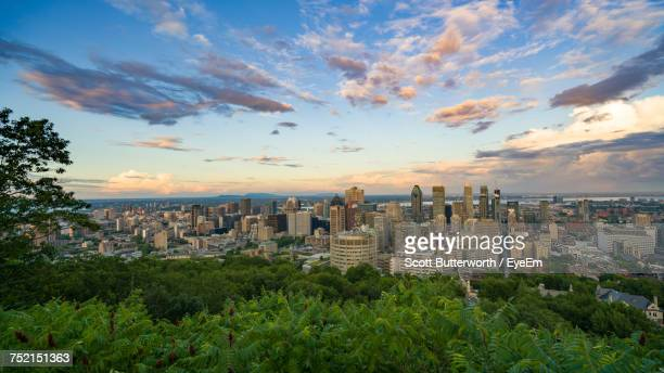 view of cityscape against cloudy sky - montreal stock pictures, royalty-free photos & images