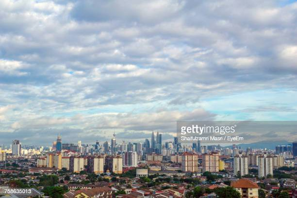 view of cityscape against cloudy sky - shaifulzamri eyeem stock pictures, royalty-free photos & images