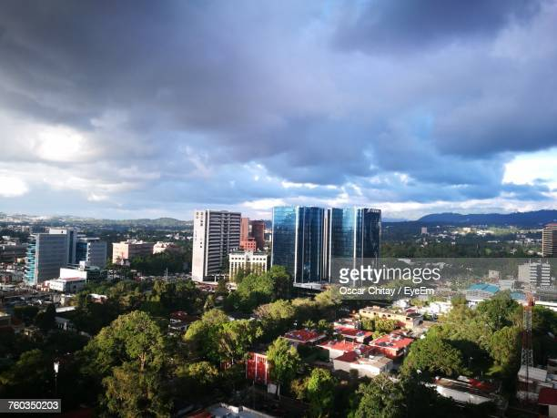 view of cityscape against cloudy sky - guatemala city stock pictures, royalty-free photos & images