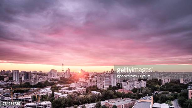 view of cityscape against cloudy sky - kiev stock pictures, royalty-free photos & images
