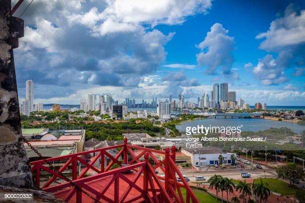 view of cityscape against cloudy sky - cartagena colombia stock photos and pictures