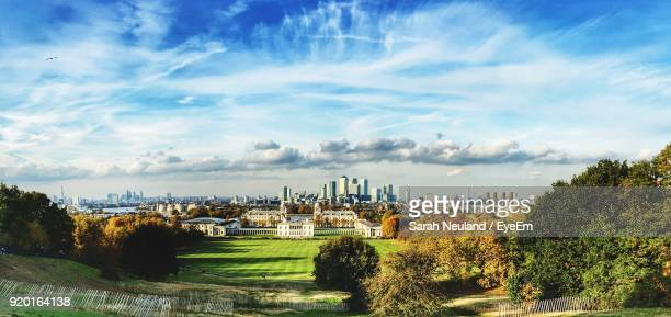 view of cityscape against cloudy sky - greenwich london stock pictures, royalty-free photos & images