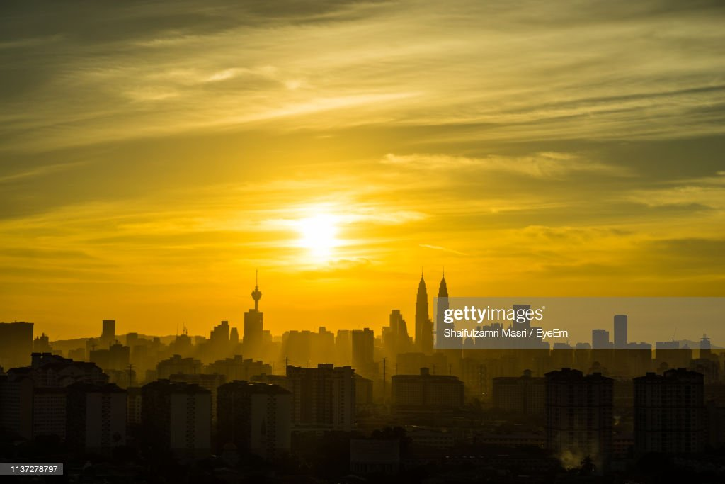 View Of Cityscape Against Dramatic Sky : Stock Photo
