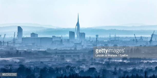 View Of Cityscape Against Sky During Foggy Weather