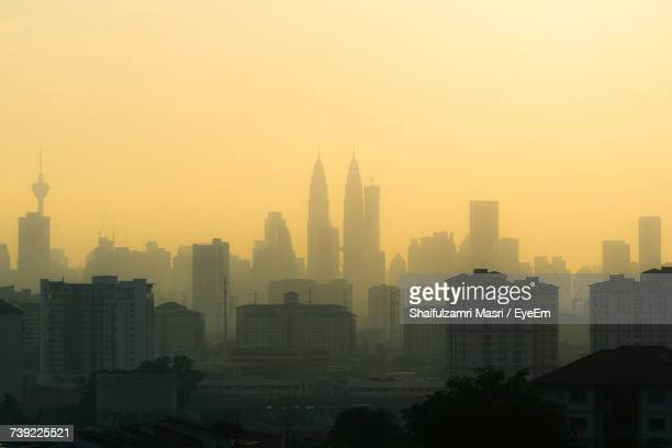 view of cityscape against sky during sunset - shaifulzamri eyeem stock pictures, royalty-free photos & images