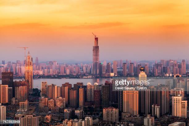 view of cityscape against sky during sunset - wuhan stock photos and pictures