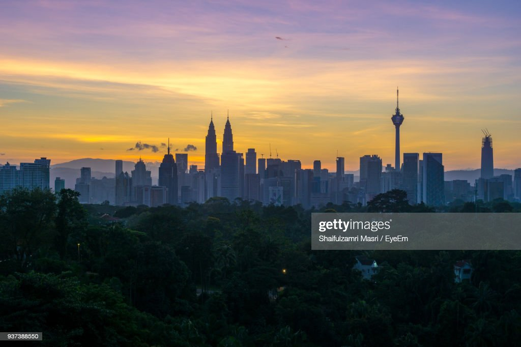 View Of Cityscape Against Sky During Sunset : Photo