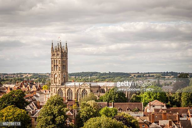 view of cityscape against sky - warwick uk stock photos and pictures